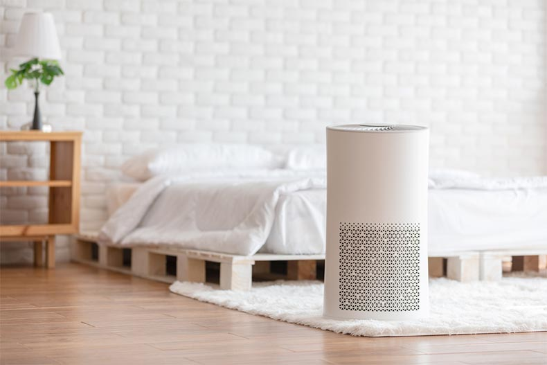An air purifier filtering the air in a clean bedroom