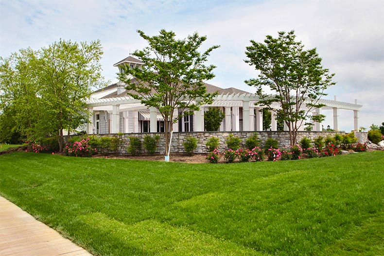 Landscaping and clubhouse exterior in Heritage Shores in Delaware
