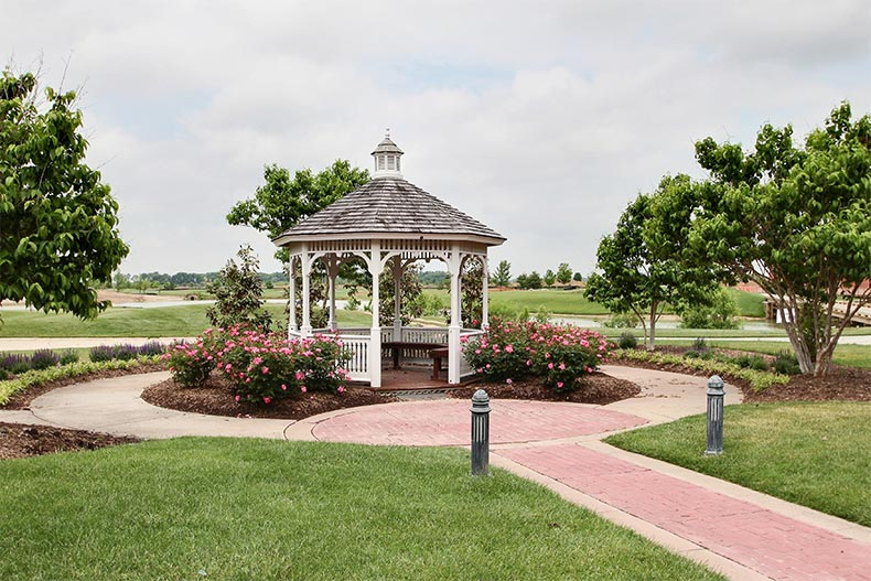 A gazebo surrounded by landscaped greenery at Heritage Shores in Bridgeville, Delaware