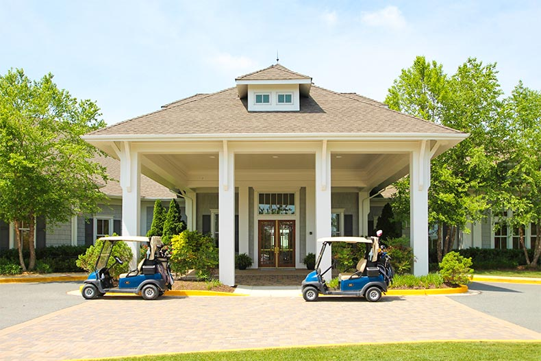 Exterior of Heritage Shores clubhouse with golf carts parked in front