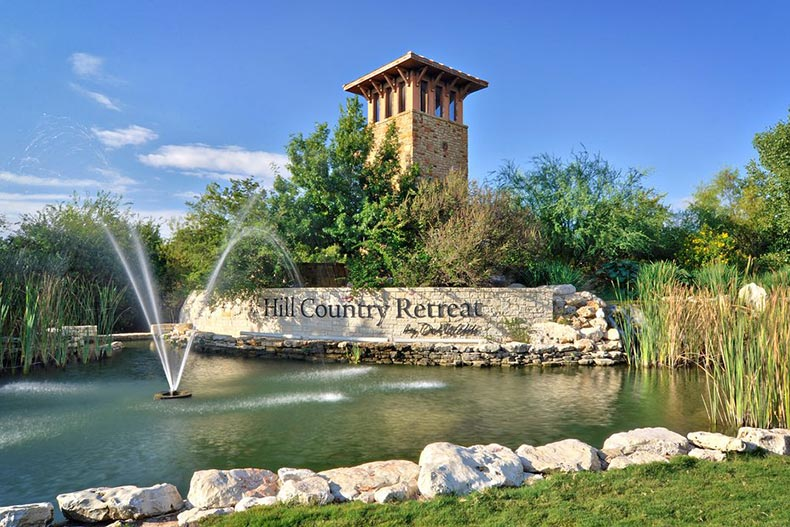 A water feature in front of the community sign for Hill Country Retreat in San Antonio, Texas
