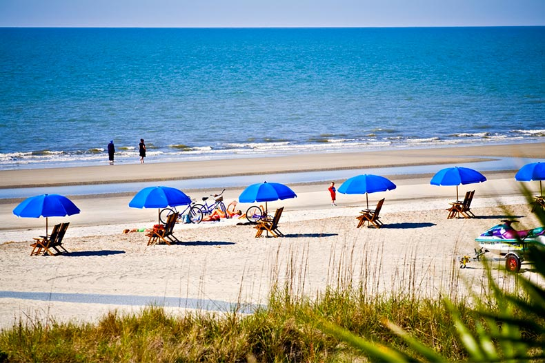 Hilton Head Island, South Carolina beach landscape with rental umbrellas, bikes, and chairs.