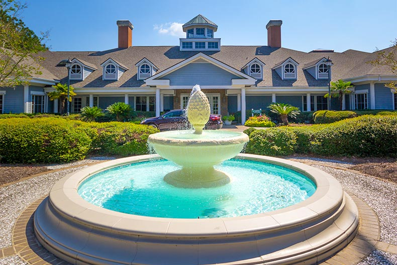 fountain and clubhouse at SunCity Hilton Head in South Carolina