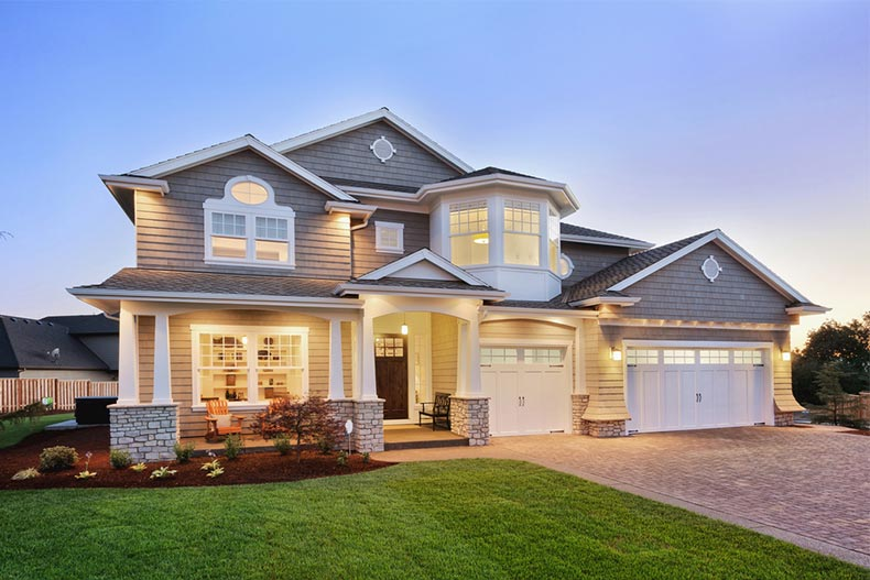 Exterior view of a new luxury home at twilight