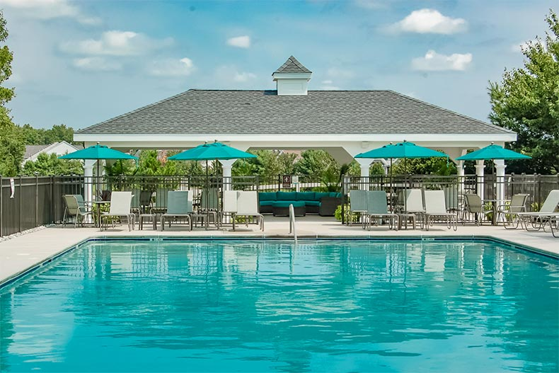 The outdoor pool and patio at Horizons at Barnegat in Barnegat, New Jersey