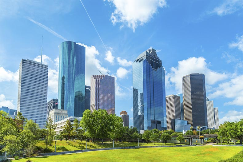The skyline of Houston, Texas under a blue sky