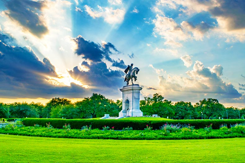 Statue and garden in Houston at sunset