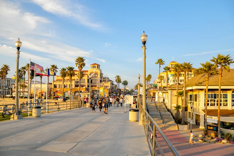 People walking down the pier at sunset in Huntington Beach, California