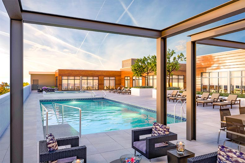 Sunset view of the outdoor pool and patio at Overture Yorktown in Lombard, Illinois