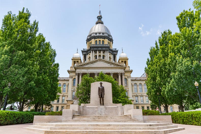 View of the Abraham Lincoln statue in front of the Illinois Capitol Building in Springfield, Illinois