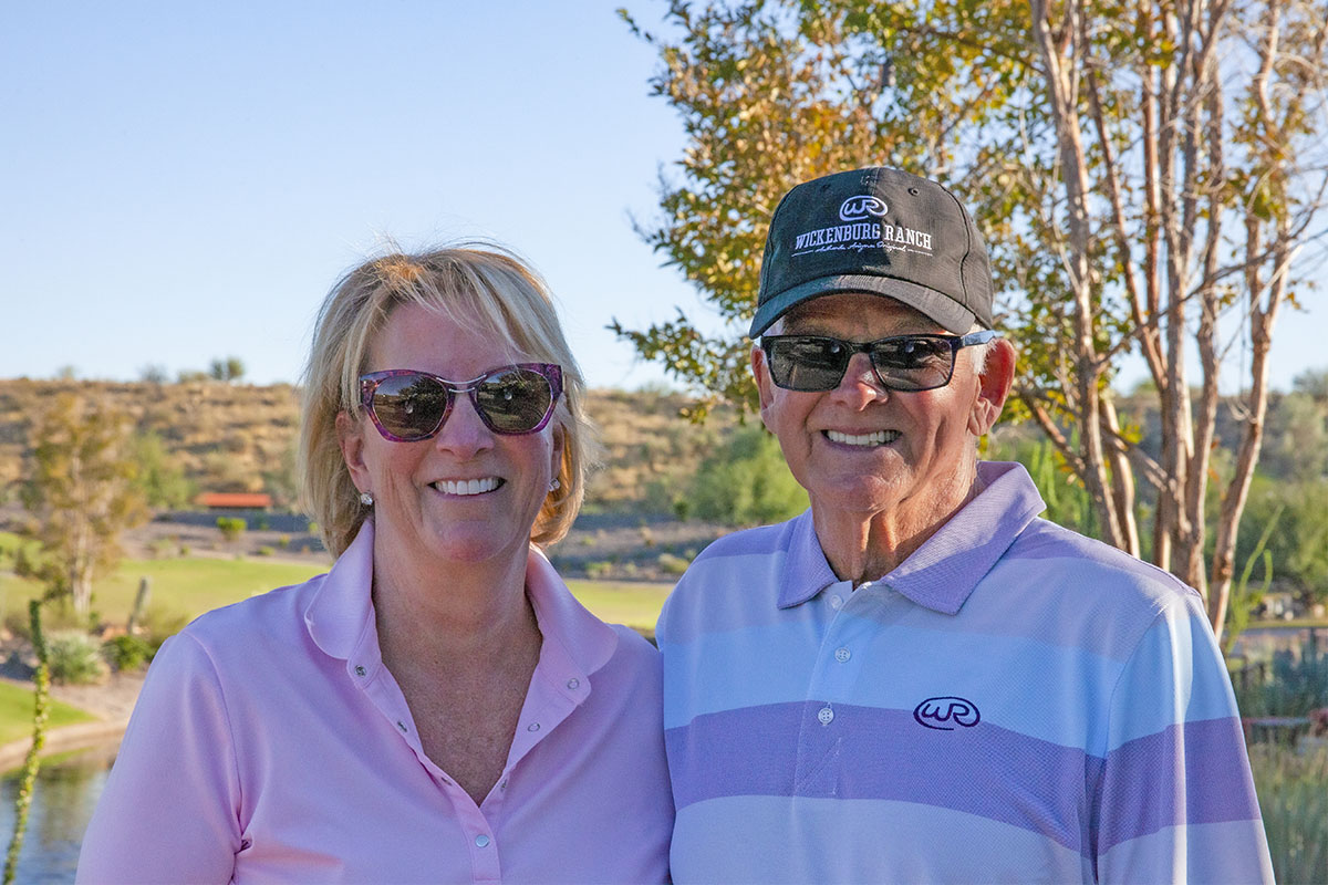 A smiling active adult couple who live at Trilogy at Wickenburg Ranch in Wickenburg, Arizona