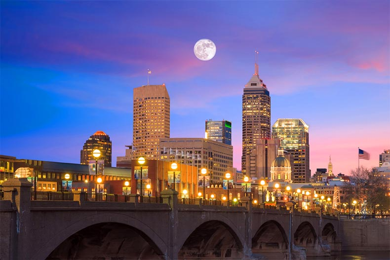 View of the Indianapolis skyline and the White River at twilight