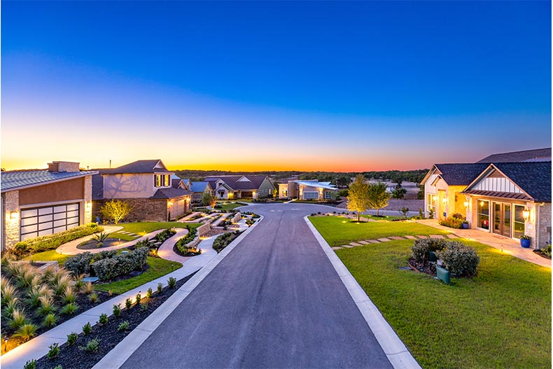 Aerial view of model homes at dusk in Kissing Tree