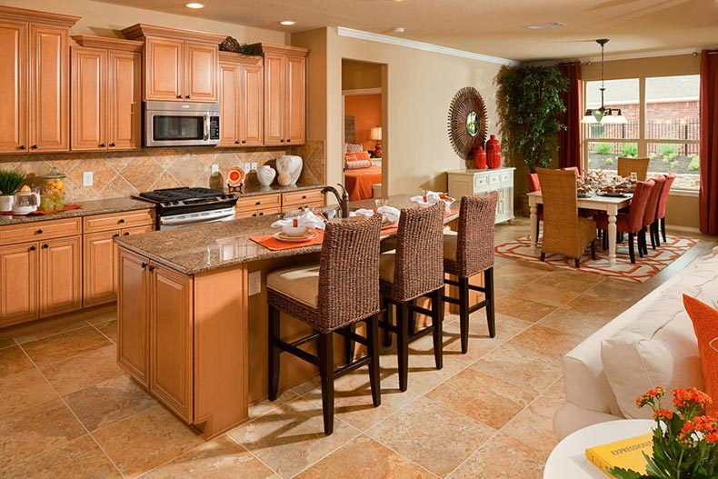 Interior view of the kitchen in a Tifton Walk home model in Del Webb Sweetgrass in Richmond, Texas