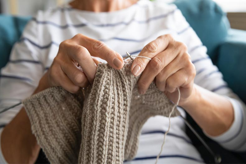 Close up of older woman knitting
