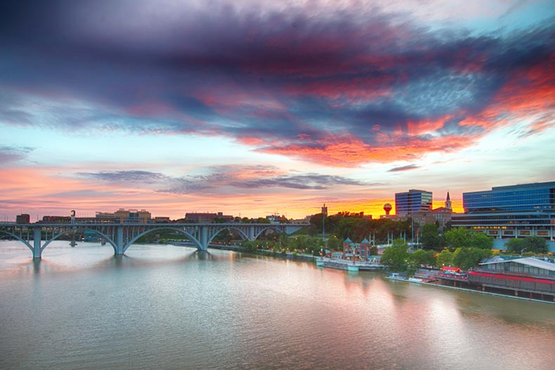 A colorful sunset over the river and skyline of Knoxville, Tennessee