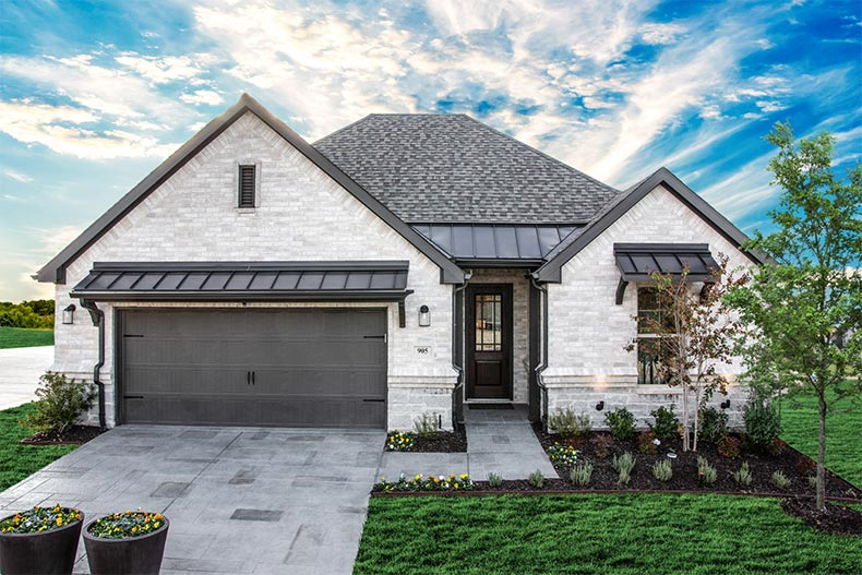 Exterior view of a model home in Ladera Rockwall in Rockwall, Texas