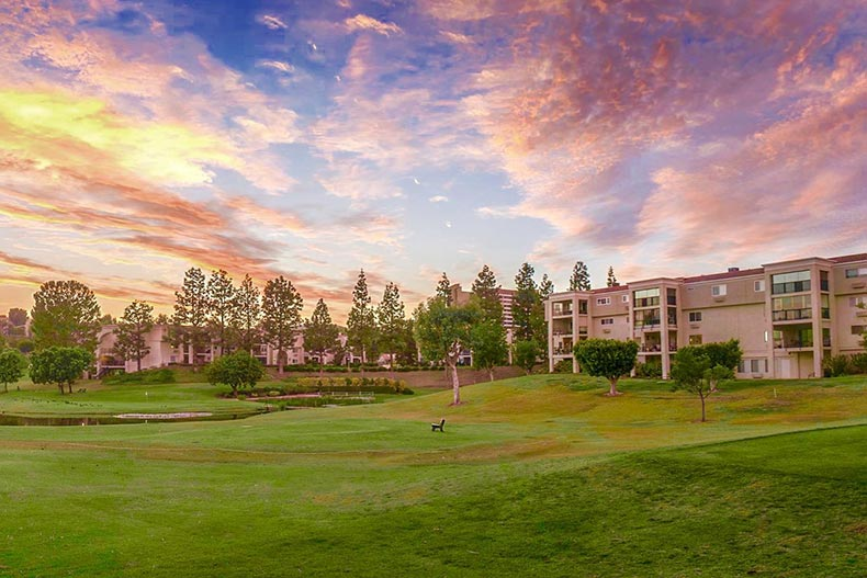 Sunset view of the golf course and condo buildings at Laguna Woods Village in Laguna Woods, California