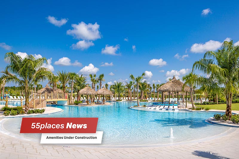 """55places News: Amenities Under Construction"" banner over a resort-style pool surrounded by palm trees at Latitude Margaritaville in Daytona Beach"