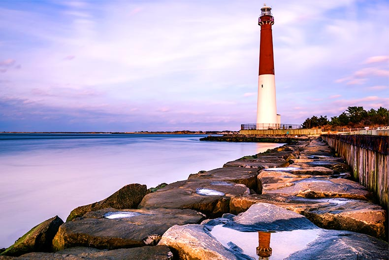 Purple evening sky and calm water at Barnegat Lighthouse State Park on Long Beach Island in New Jersey