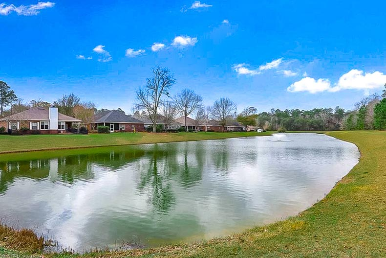 Houses beside a picturesque pond at LiveOak Village in Foley, Alabama