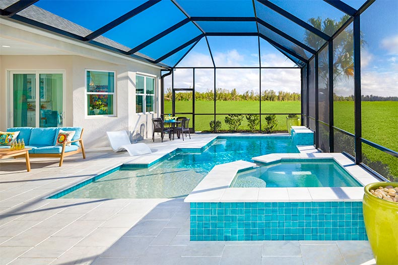 Screened in pool and spa in Latitude Margaritaville home
