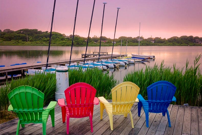 Colorful deck chairs along a dock at Montauk Bay in Long Island, New York