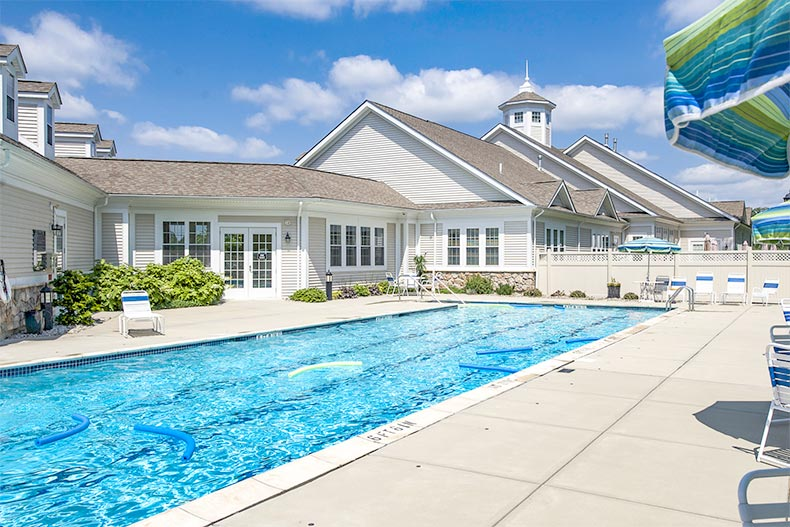 View of the outdoor pool and patio at Del Webb Chauncy Lake in Westborough, Massachusetts