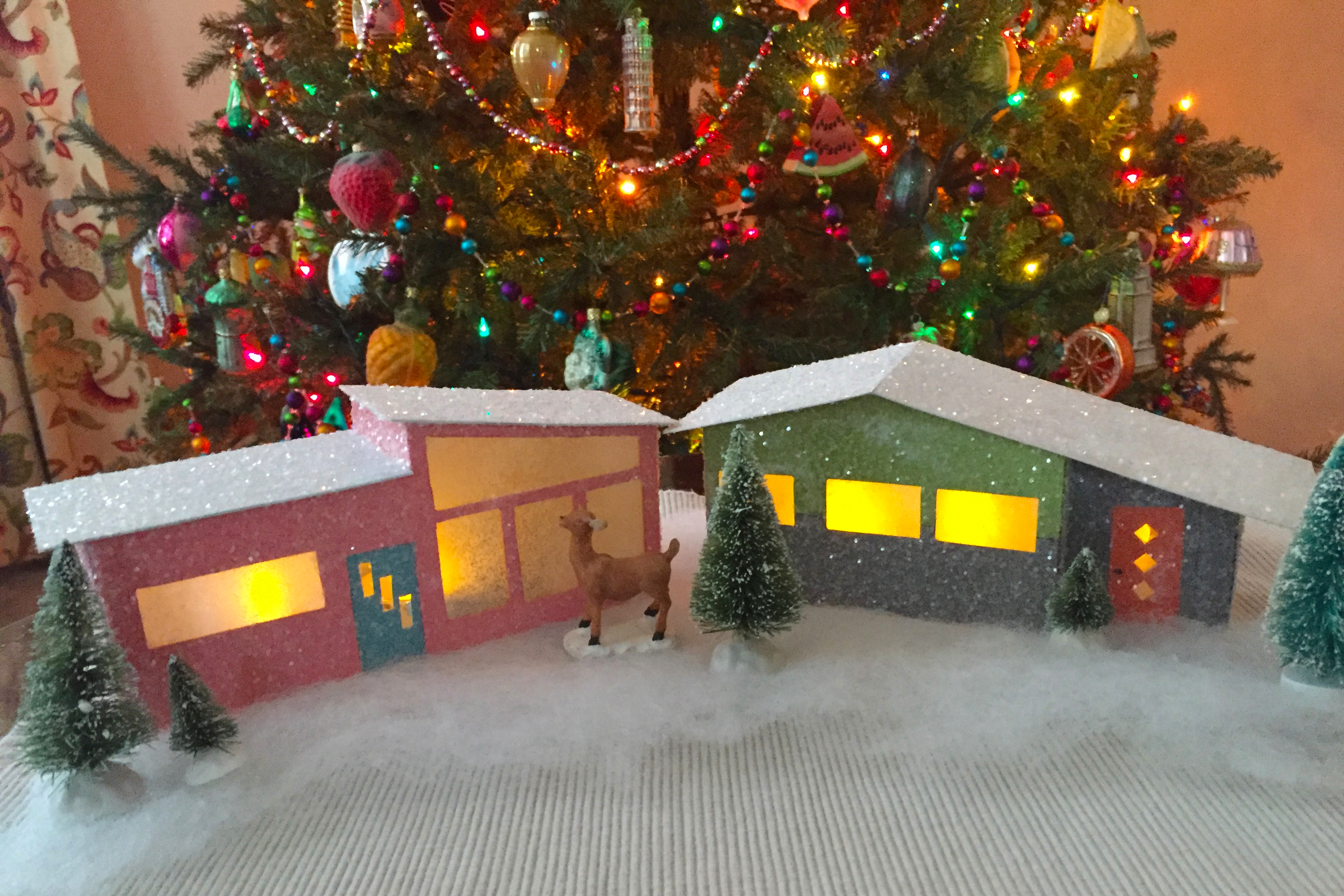 A holiday themed putz house is a great holiday craft activity to take on this year.