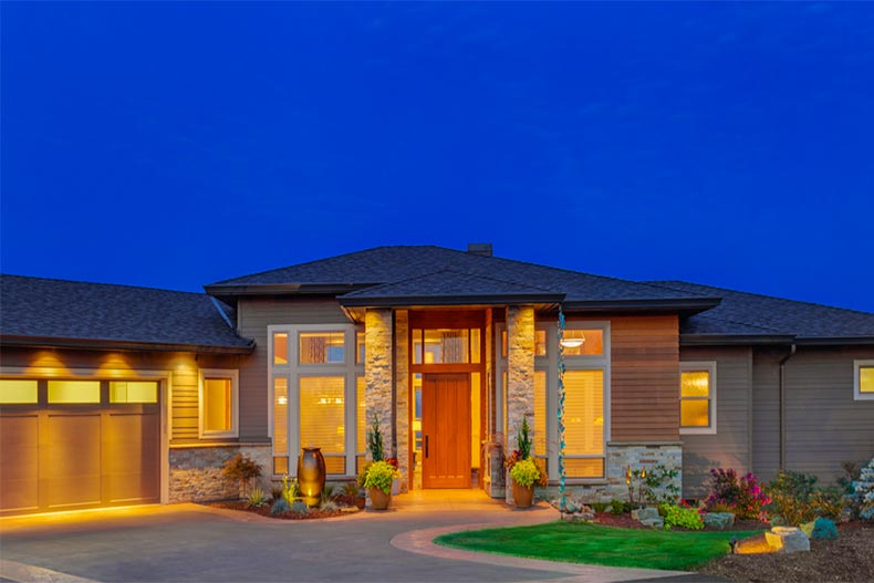 close up of new, ranch-style home at twilight