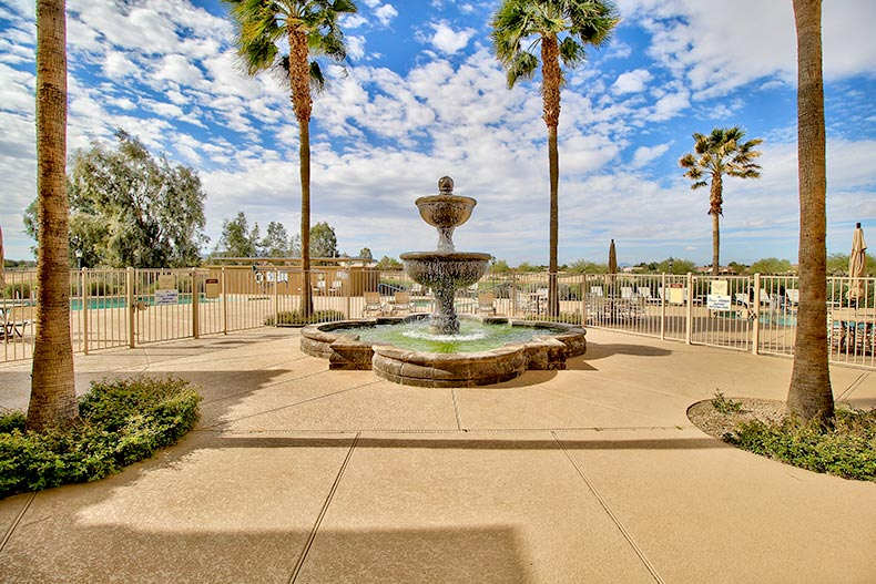 View of the fountain and palm trees near the entrance to Mission Royale in Casa Grande, Arizona