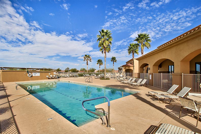 View of the outdoor pool and patio at Mission Royale in Casa Grande, Arizona