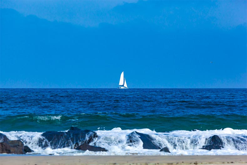 Sailboat off the shore of a beach in Monmouth County, New Jersey
