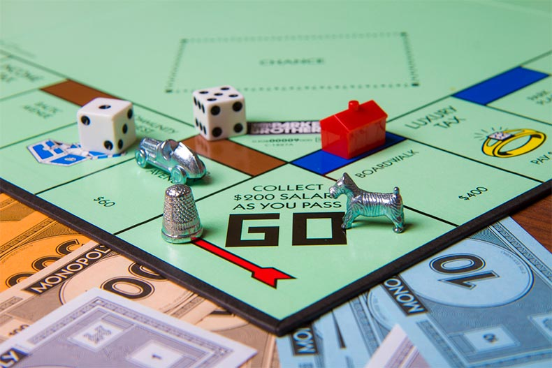 Close up a Monopoly board and game pieces