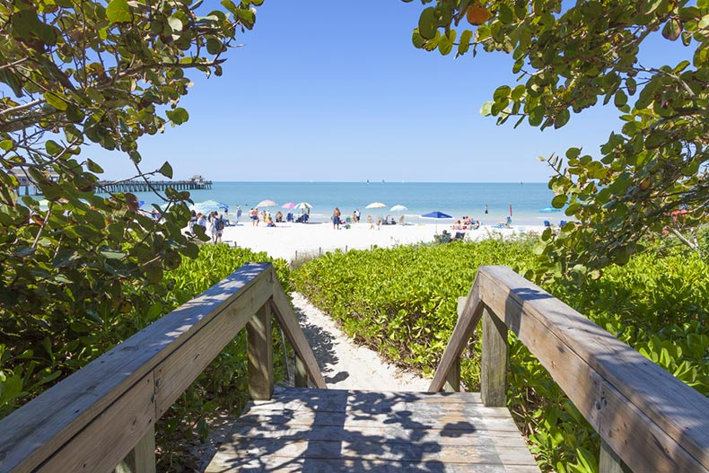 Access path to a white sand beach in Naples, Florida