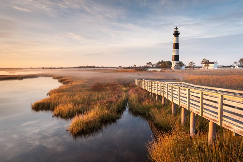 View of the boardwalk leading to Bodie Island Lighthouse in North Carolina on an autumn morning