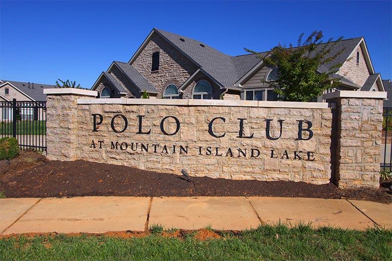 View of the community sign near the front gate of The Polo Club at Mountain Island Lake in Charlotte, North Carolina