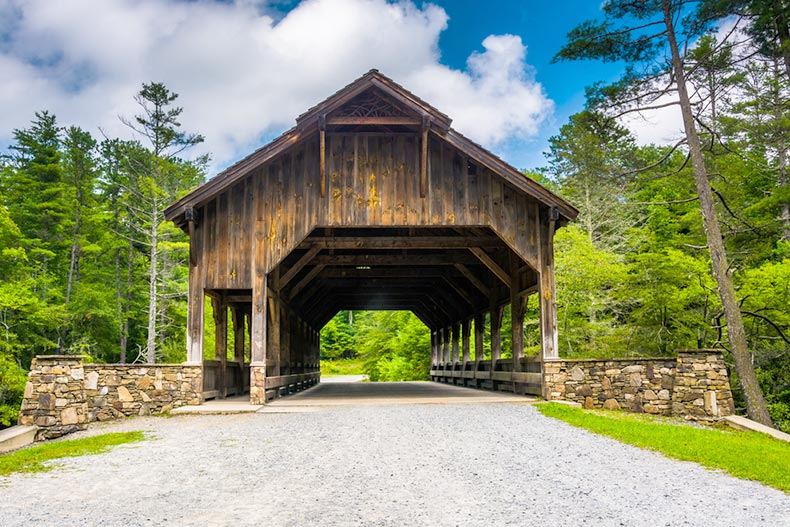 Blue sky over the covered bridge above High Falls in Dupont State Forest, North Carolina