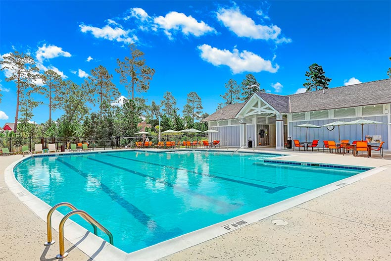 View of the outdoor pool and patio at Brunswick Forest in Leland, North Carolina
