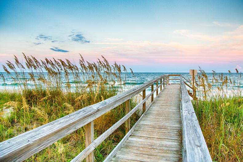 View down a boardwalk leading to Kure Beach on North Carolina's Atlantic coast