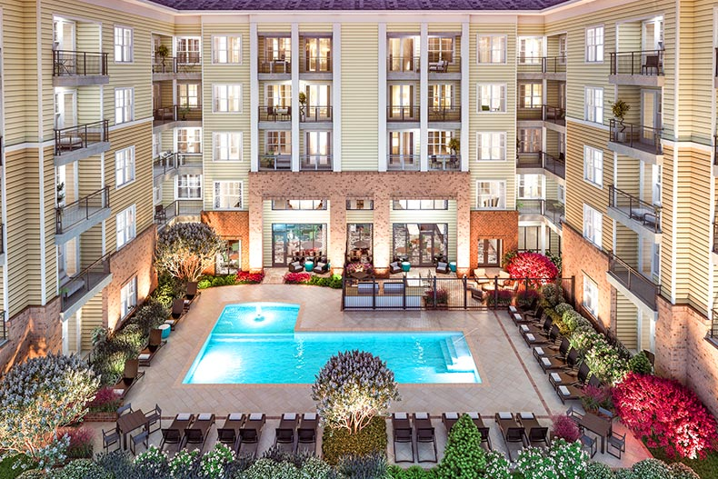 Apartments surrounding an outdoor pool at Overture Providence in Charlotte, North Carolina