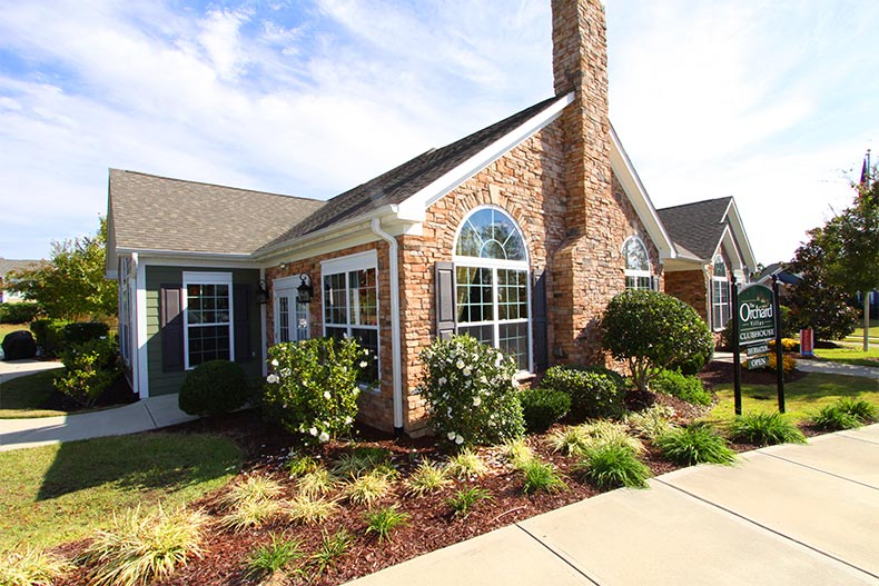 Exterior view of the clubhouse at The Orchard Villas in Apex, North Carolina