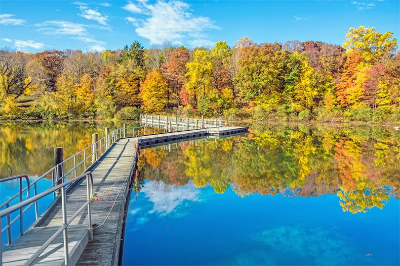 Blue sky over a footbridge across George Lake at Schooly's Mountain Park in Morris County, New Jersey
