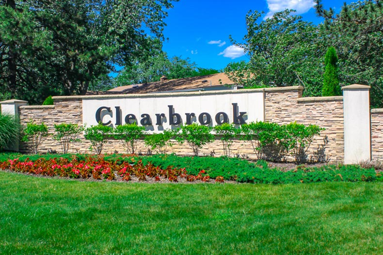 View of the community sign at Clearbrook in Monroe, New Jersey