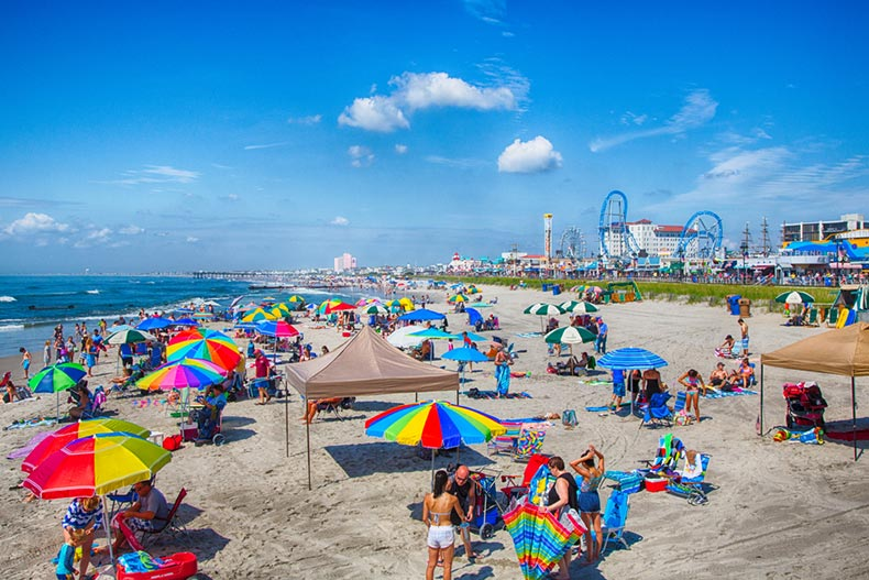 Vacationers enjoying the sun and sand on the boardwalk and beach in Ocean City, New Jersey
