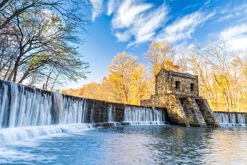 A blue sky over Speedwell dam and waterfall on the Whippany River in Morristown, New Jersey