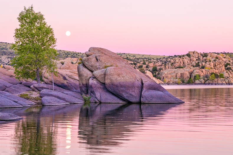 Sunset over the rocky shores of Lake Watson in Prescott, Arizona