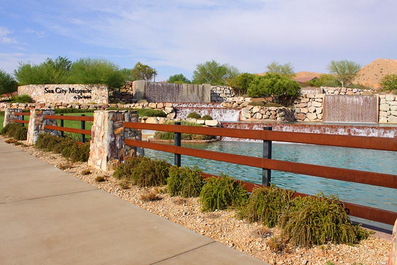 View of the pond and water features near the community sign for Sun City Mesquite in Mesquite, Nevada