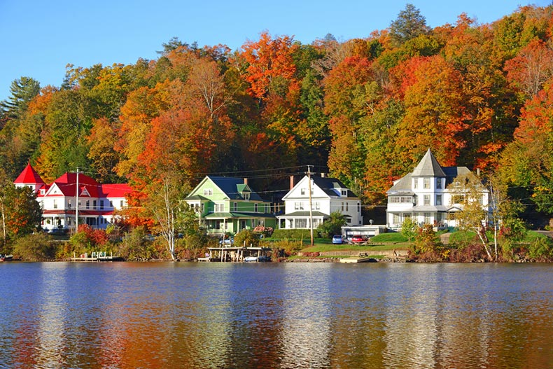 Houses and autumn foliage along Saranac Lake in the Adirondacks in New York State