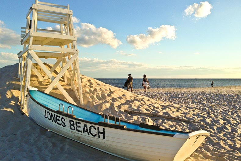 View of a life guard stand and row boat on the sand at Jones Beach in Long Island, New York